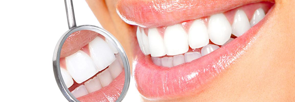 Белоснежная улыбка и стоматологическое зеркало